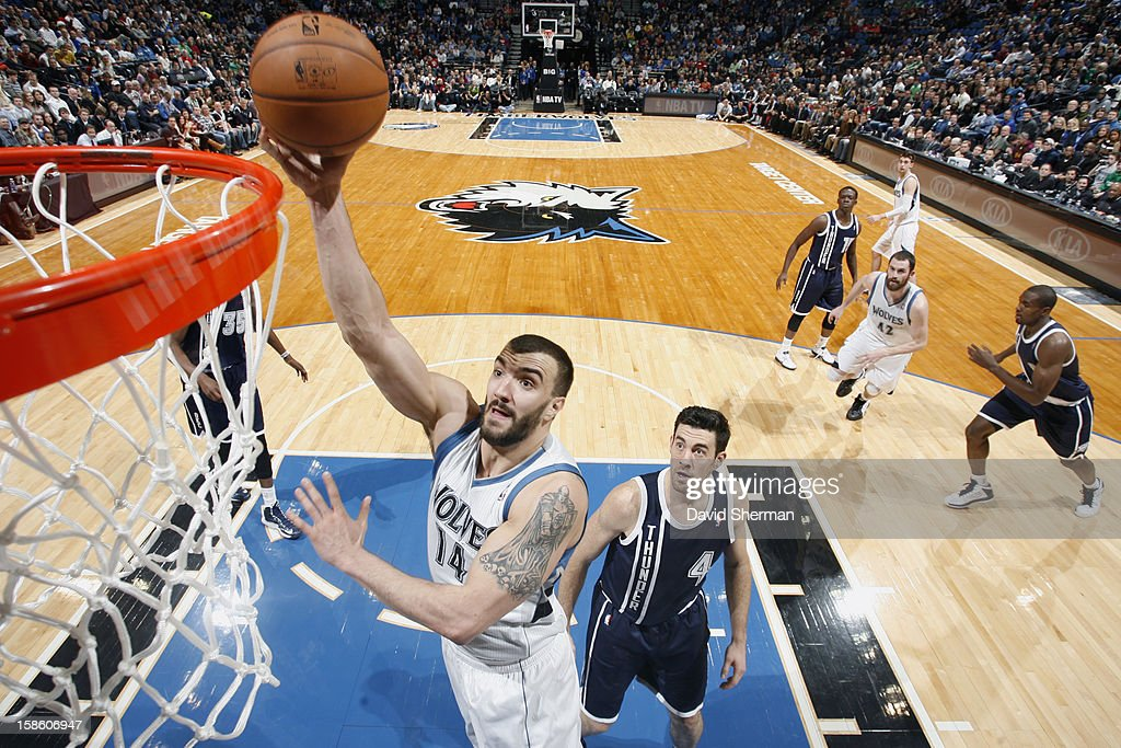 Nikola Pekovic #14 of the Minnesota Timberwolves goes up for the easy basket against the Oklahoma City Thunder during the game on December 20, 2012 at Target Center in Minneapolis, Minnesota.