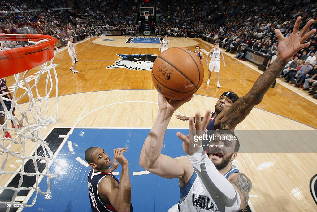 Nikola Pekovic #14 of the Minnesota Timberwolves goes up for the shot while Josh Smith #5 of the Atlanta Hawks attempts to block his shot during the game on January 8, 2013 at Target Center in Minneapolis, Minnesota.