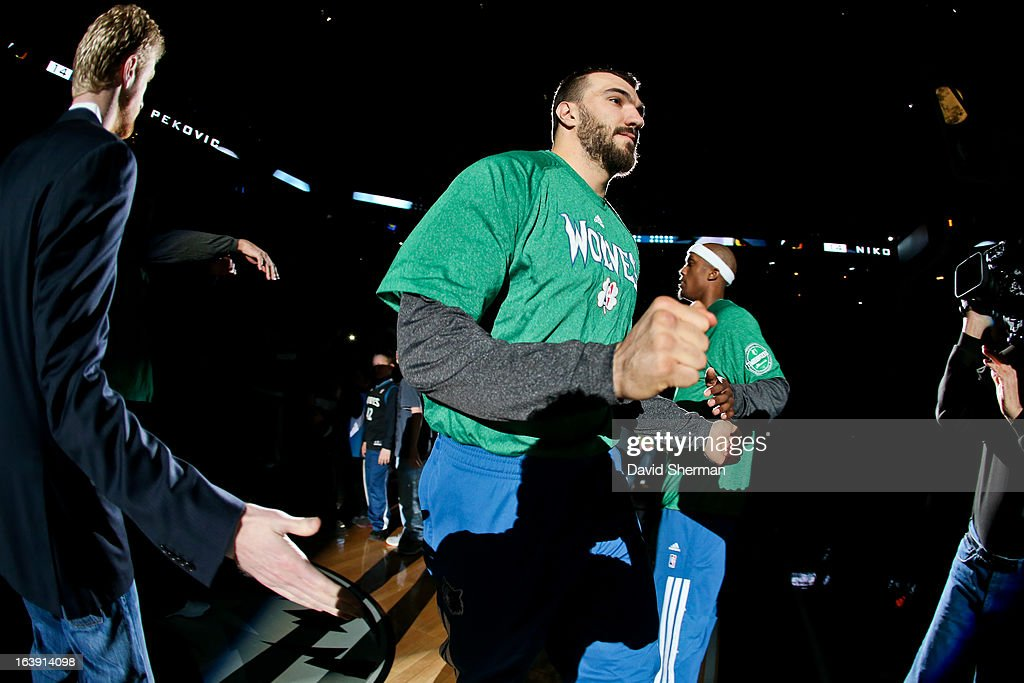 Nikola Pekovic #14 of the Minnesota Timberwolves greets teammates before playing against the New Orleans Hornets on March 17, 2013 at Target Center in Minneapolis, Minnesota.