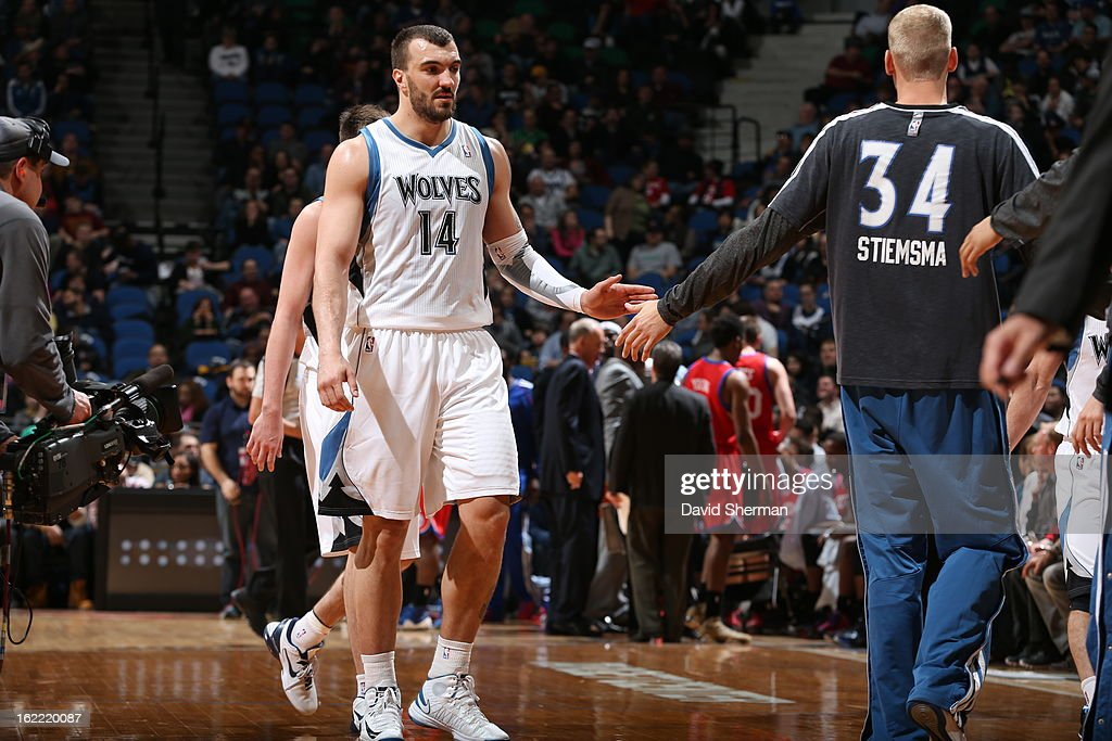 Nikola Pekovic #14 of the Minnesota Timberwolves is congratulated by teammate Greg Stiemsma #34 during the game between Philadelphia 76ers and the Minnesota Timberwolves on February 20, 2013 at Target Center in Minneapolis, Minnesota.
