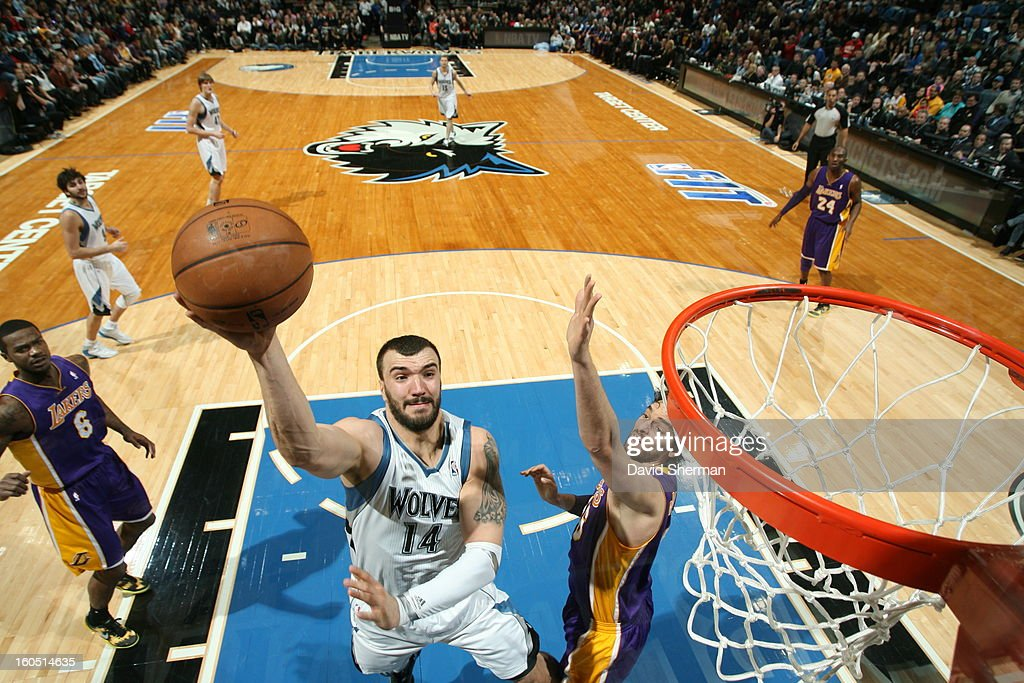 <a gi-track='captionPersonalityLinkClicked' href=/galleries/search?phrase=Nikola+Pekovic&family=editorial&specificpeople=829137 ng-click='$event.stopPropagation()'>Nikola Pekovic</a> #14 of the Minnesota Timberwolves looks to bank one off the glass against the Los Angeles Lakers during the game on February 1, 2013 at Target Center in Minneapolis, Minnesota.