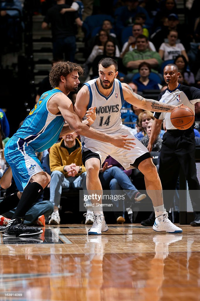 Nikola Pekovic #14 of the Minnesota Timberwolves posts-up against Robin Lopez #15 of the New Orleans Hornets on March 17, 2013 at Target Center in Minneapolis, Minnesota.