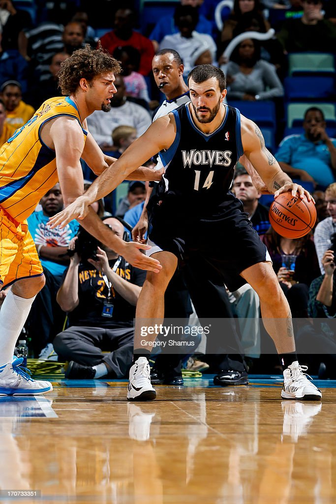 <a gi-track='captionPersonalityLinkClicked' href=/galleries/search?phrase=Nikola+Pekovic&family=editorial&specificpeople=829137 ng-click='$event.stopPropagation()'>Nikola Pekovic</a> #14 of the Minnesota Timberwolves posts-up against <a gi-track='captionPersonalityLinkClicked' href=/galleries/search?phrase=Robin+Lopez&family=editorial&specificpeople=2351509 ng-click='$event.stopPropagation()'>Robin Lopez</a> #15 of the New Orleans Hornets on December 14, 2012 at the New Orleans Arena in New Orleans, Louisiana.