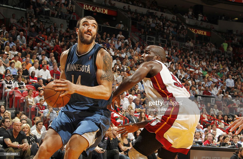 <a gi-track='captionPersonalityLinkClicked' href=/galleries/search?phrase=Nikola+Pekovic&family=editorial&specificpeople=829137 ng-click='$event.stopPropagation()'>Nikola Pekovic</a> #14 of the Minnesota Timberwolves protects the ball from <a gi-track='captionPersonalityLinkClicked' href=/galleries/search?phrase=Joel+Anthony&family=editorial&specificpeople=4092295 ng-click='$event.stopPropagation()'>Joel Anthony</a> #50 of the Miami Heat during a game between the Minnesota Timberwolves and the Miami Heat on December 18, 2012 at American Airlines Arena in Miami, Florida.