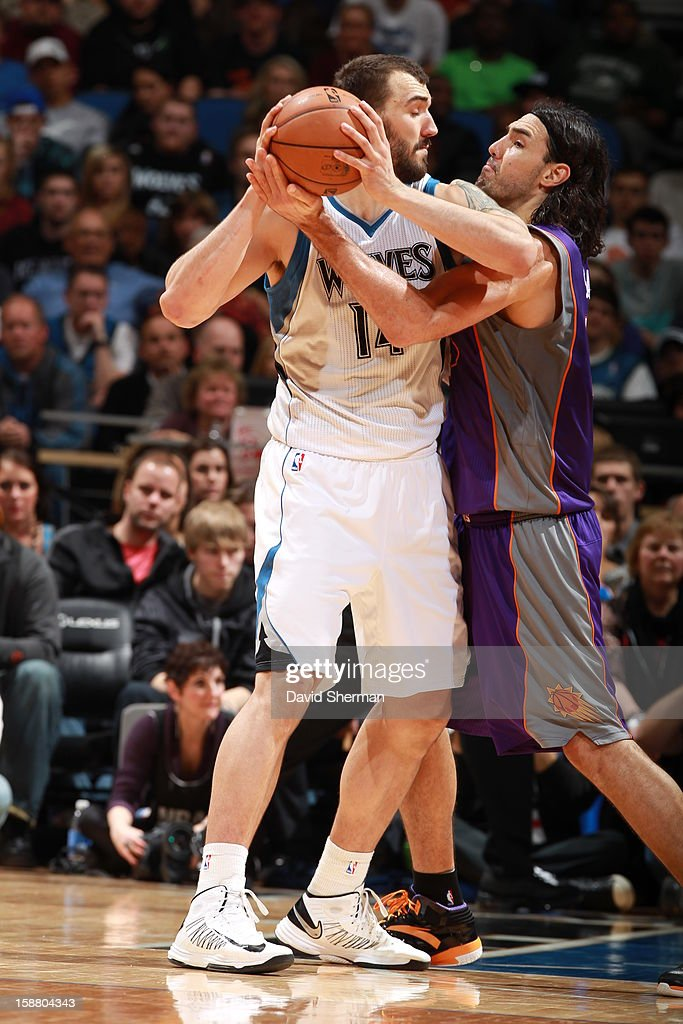 <a gi-track='captionPersonalityLinkClicked' href=/galleries/search?phrase=Nikola+Pekovic&family=editorial&specificpeople=829137 ng-click='$event.stopPropagation()'>Nikola Pekovic</a> #14 of the Minnesota Timberwolves protects the ball from <a gi-track='captionPersonalityLinkClicked' href=/galleries/search?phrase=Luis+Scola&family=editorial&specificpeople=2464749 ng-click='$event.stopPropagation()'>Luis Scola</a> #14 of the Phoenix Suns during the game between the Minnesota Timberwolves and the Phoenix Suns during the game on December 29, 2012 at Target Center in Minneapolis, Minnesota.