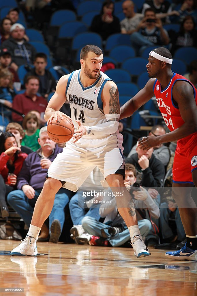 Nikola Pekovic #14 of the Minnesota Timberwolves protects the ball from Kwame Brown #54 of the Philadelphia 76ers during the game between Philadelphia 76ers and the Minnesota Timberwolves on February 20, 2013 at Target Center in Minneapolis, Minnesota.