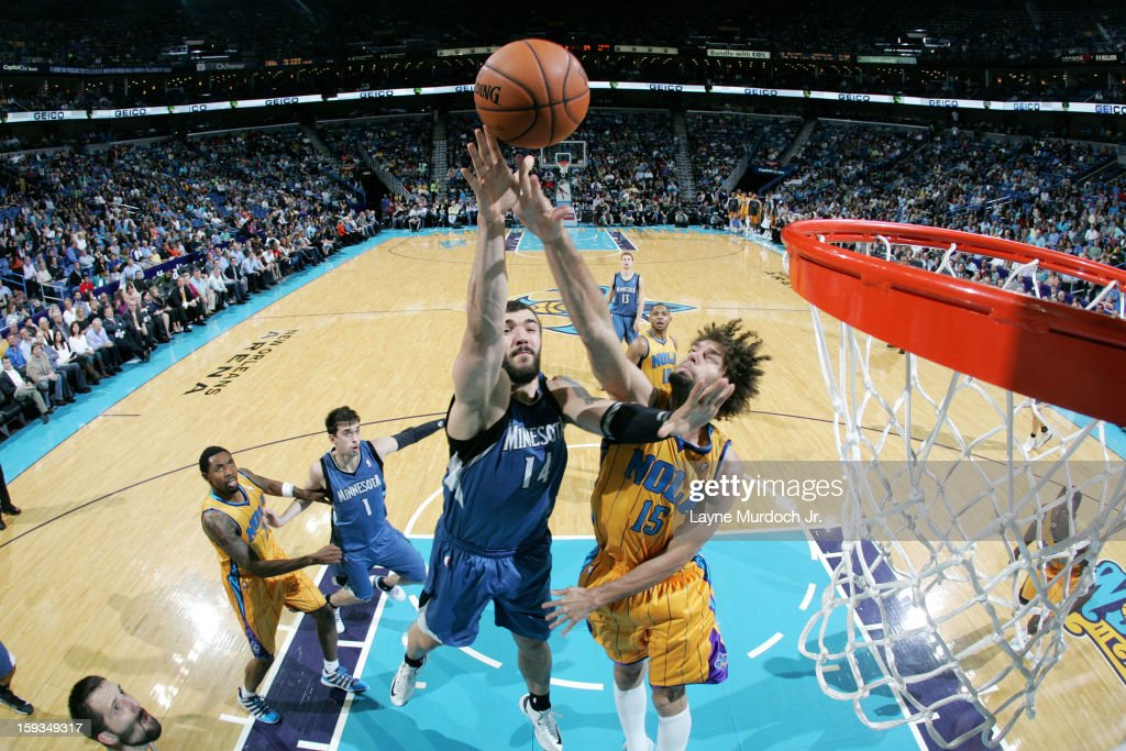 <a gi-track='captionPersonalityLinkClicked' href=/galleries/search?phrase=Nikola+Pekovic&family=editorial&specificpeople=829137 ng-click='$event.stopPropagation()'>Nikola Pekovic</a> #14 of the Minnesota Timberwolves puts up a shot pver <a gi-track='captionPersonalityLinkClicked' href=/galleries/search?phrase=Robin+Lopez&family=editorial&specificpeople=2351509 ng-click='$event.stopPropagation()'>Robin Lopez</a> #15 of the New Orleans Hornets on January 11, 2013 at the New Orleans Arena in New Orleans, Louisiana.