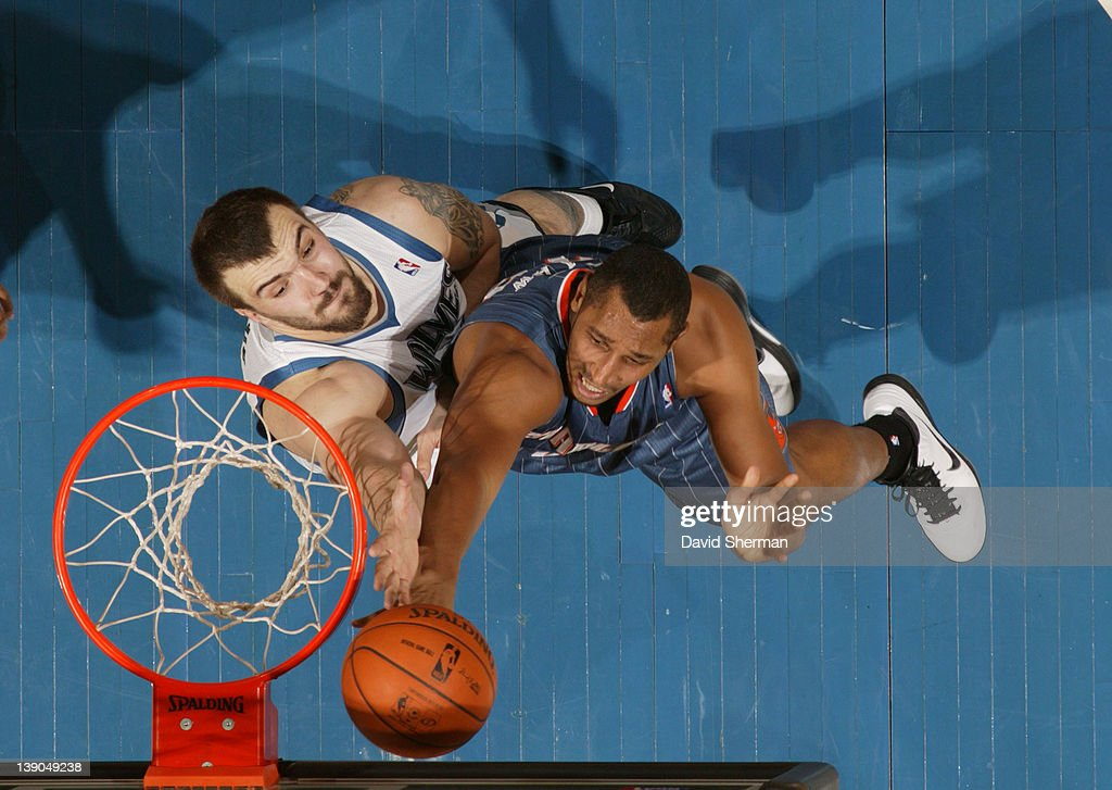 Nikola Pekovic #14 of the Minnesota Timberwolves reaches for the ball against Boris Diaw #32 of the Charlotte Bobcats during the game on February 15, 2012 at Target Center in Minneapolis, Minnesota.
