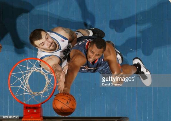 Nikola Pekovic of the Minnesota Timberwolves reaches for the ball against Boris Diaw of the Charlotte Bobcats during the game on February 15 2012 at...