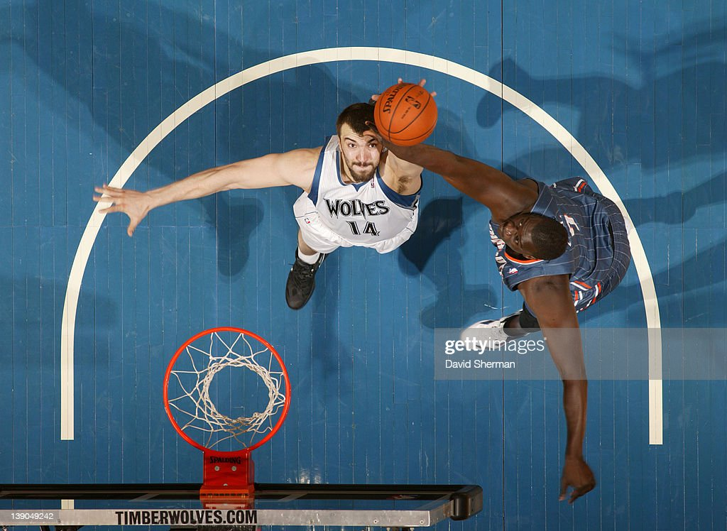 Nikola Pekovic #14 of the Minnesota Timberwolves reaches for the ball against DeSagana Diop #7 of the Charlotte Bobcats during the game on February 15, 2012 at Target Center in Minneapolis, Minnesota.