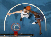 Nikola Pekovic of the Minnesota Timberwolves reaches for the ball against DeSagana Diop of the Charlotte Bobcats during the game on February 15 2012...