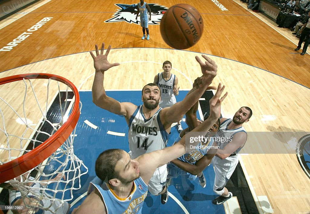 Nikola Pekovic #14 of the Minnesota Timberwolves reaches for the ball during the game between the Minnesota Timberwolves and the Denver Nuggets on November 21, 2012 at Target Center in Minneapolis, Minnesota.