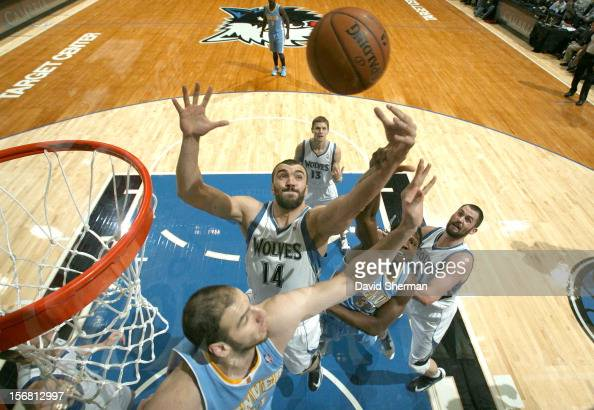 Nikola Pekovic of the Minnesota Timberwolves reaches for the ball during the game between the Minnesota Timberwolves and the Denver Nuggets on...