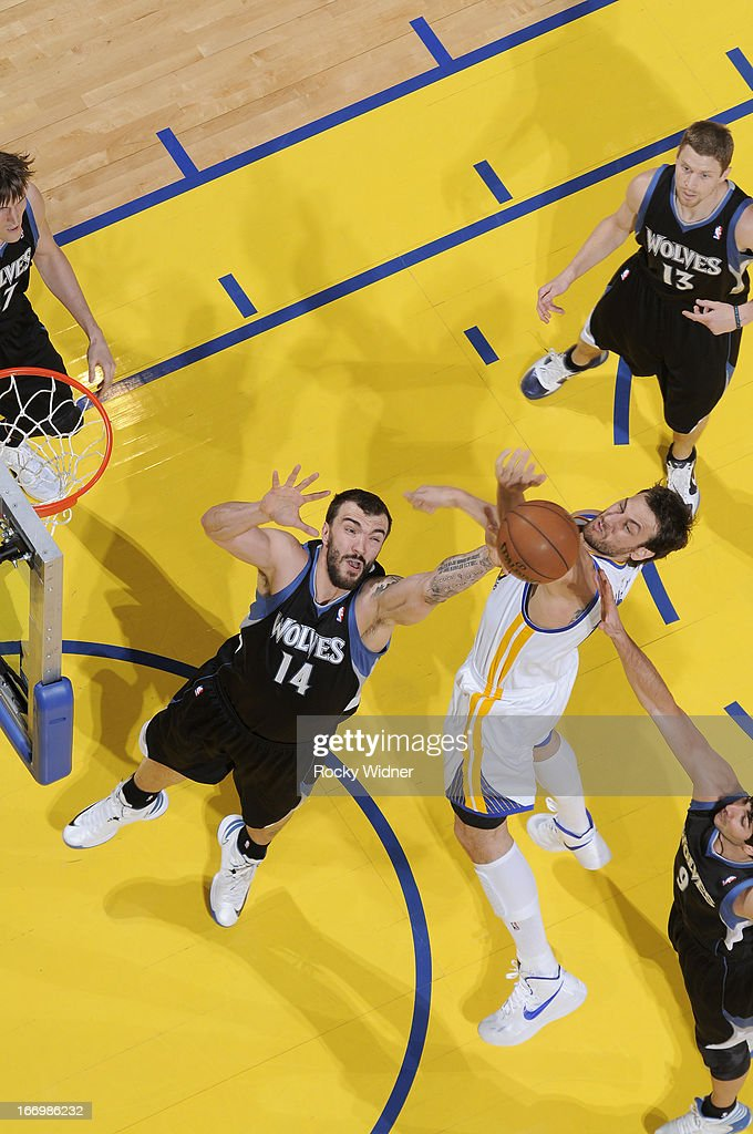 <a gi-track='captionPersonalityLinkClicked' href=/galleries/search?phrase=Nikola+Pekovic&family=editorial&specificpeople=829137 ng-click='$event.stopPropagation()'>Nikola Pekovic</a> #14 of the Minnesota Timberwolves rebounds against <a gi-track='captionPersonalityLinkClicked' href=/galleries/search?phrase=Andrew+Bogut&family=editorial&specificpeople=207105 ng-click='$event.stopPropagation()'>Andrew Bogut</a> #12 of the Golden State Warriors on April 9, 2013 at Oracle Arena in Oakland, California.
