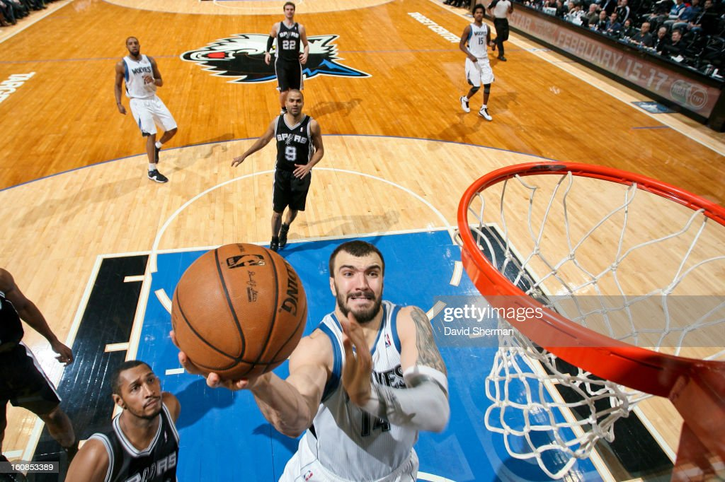 Nikola Pekovic #14 of the Minnesota Timberwolves shoots a layup against the San Antonio Spurs on February 6, 2013 at Target Center in Minneapolis, Minnesota.