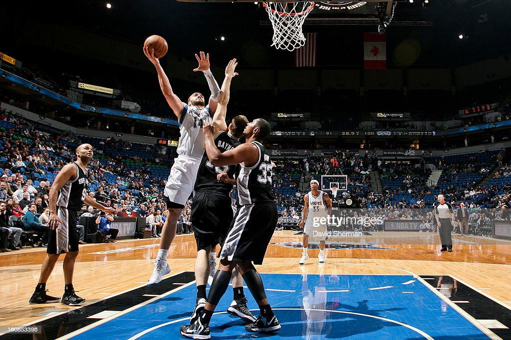 Nikola Pekovic #14 of the Minnesota Timberwolves shoots a layup against Aron Baynes #16 of the San Antonio Spurs on February 6, 2013 at Target Center in Minneapolis, Minnesota.