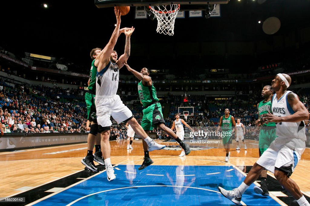 <a gi-track='captionPersonalityLinkClicked' href=/galleries/search?phrase=Nikola+Pekovic&family=editorial&specificpeople=829137 ng-click='$event.stopPropagation()'>Nikola Pekovic</a> #14 of the Minnesota Timberwolves shoots a layup against <a gi-track='captionPersonalityLinkClicked' href=/galleries/search?phrase=Shavlik+Randolph&family=editorial&specificpeople=210678 ng-click='$event.stopPropagation()'>Shavlik Randolph</a> #42 of the Boston Celtics on April 1, 2013 at Target Center in Minneapolis, Minnesota.