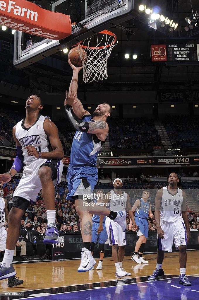 Nikola Pekovic #14 of the Minnesota Timberwolves shoots against Jason Thompson #34 of the Sacramento Kings on March 21, 2013 at Sleep Train Arena in Sacramento, California.