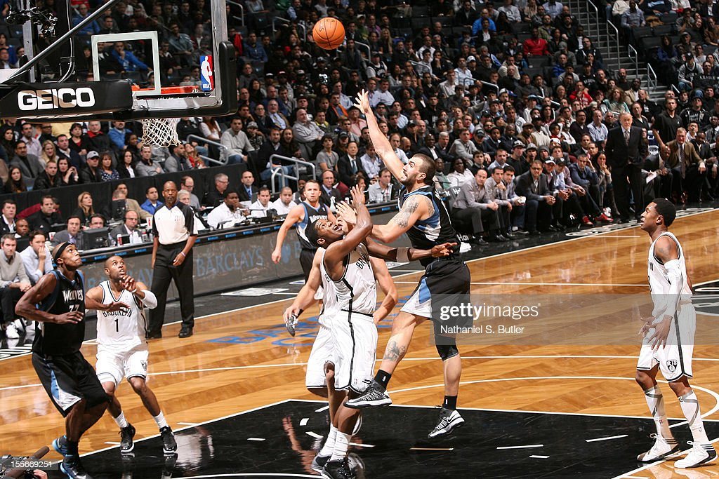 Nikola Pekovic #14 of the Minnesota Timberwolves shoots against Joe Johnson #7 of the Brooklyn Nets on November 5, 2012 at the Barclays Center in Brooklyn, New York.