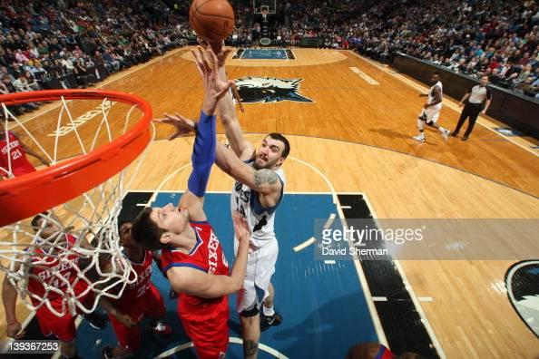 Nikola Pekovic of the Minnesota Timberwolves shoots against Nikola Vucevic of the Philadelphia 76ers on February 19 2012 at Target Center in...