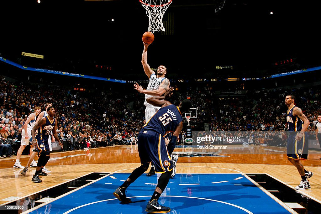 Nikola Pekovic #14 of the Minnesota Timberwolves shoots against Roy Hibbert #55 of the Indiana Pacers on November 9, 2012 at Target Center in Minneapolis, Minnesota.