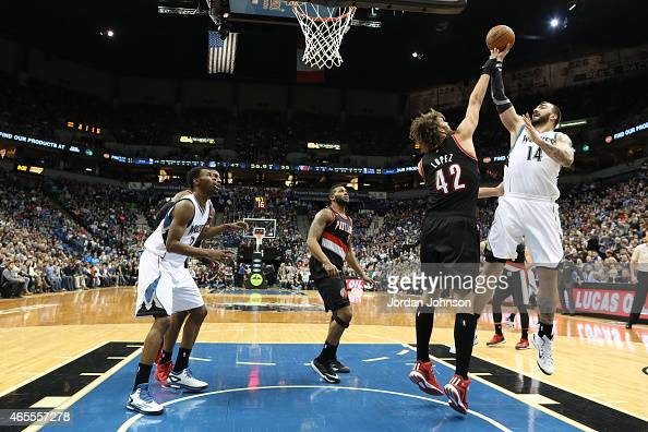Nikola Pekovic of the Minnesota Timberwolves shoots against the Portland Trail Blazers during the game on March 7 2015 at Target Center in...