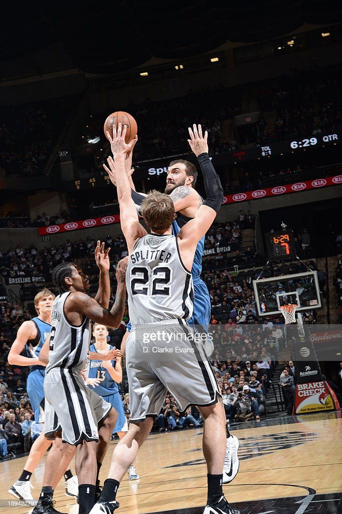 Nikola Pekovic #14 of the Minnesota Timberwolves shoots against Tiago Splitter #22 of the San Antonio Spurs on January 13, 2013 at the AT&T Center in San Antonio, Texas.