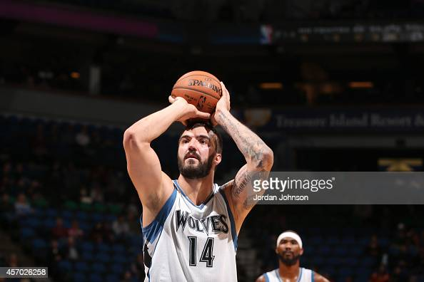 Nikola Pekovic of the Minnesota Timberwolves shoots the ball against the Philadelphia 76ers during the game on October 10 2014 at Target Center in...