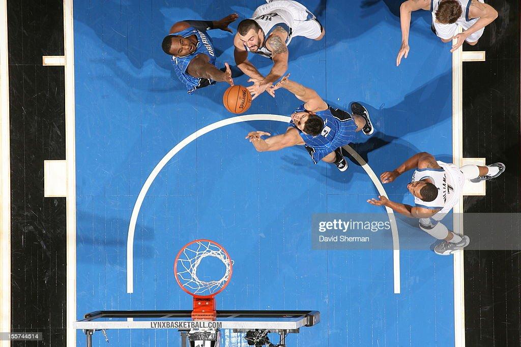 Nikola Pekovic #14 of the Minnesota Timberwolves splits defense defense during the game between the Minnesota Timberwolves and the Orlando Magic on November 7, 2012 at Target Center in Minneapolis, Minnesota.