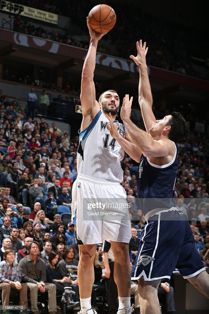 <a gi-track='captionPersonalityLinkClicked' href=/galleries/search?phrase=Nikola+Pekovic&family=editorial&specificpeople=829137 ng-click='$event.stopPropagation()'>Nikola Pekovic</a> #14 of the Minnesota Timberwolves takes a shot against the Oklahoma City Thunder on December 20, 2012 at Target Center in Minneapolis, Minnesota.