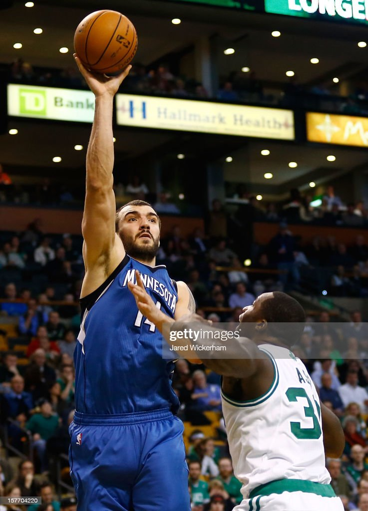 Nikola Pekovic #14 of the Minnesota Timberwolves takes a shot over Brandon Bass #30 of the Boston Celtics during the game on December 5, 2012 at TD Garden in Boston, Massachusetts.