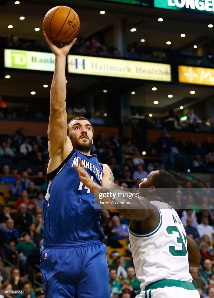 Nikola Pekovic #14 of the Minnesota Timberwolves takes a shot over Brandon Bass #30 of the Boston Celtics during the game on December 5, 2012 at TD Garden in Boston, Massachusetts.