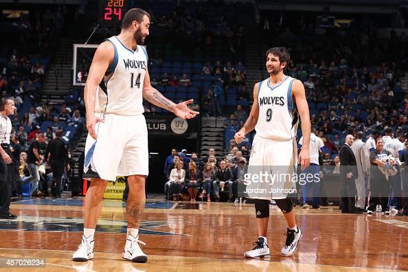 Nikola Pekovic of the Minnesota Timberwolves talks to teammate Ricky Rubio of the Minnesota Timberwolves during the game on October 10 2014 at...