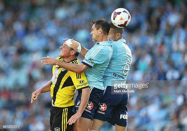 Nikola Petkovic of Sydney and Ben Sigmund of the Phoenix compete for the ball during the round seven ALeague match between Sydney FC and the...