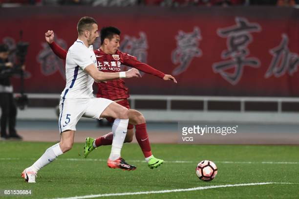 Nikola Petkovic of Yanbian Fude FC competes with Wu Lei of Shanghai SIPG for the ball during the 2nd round match of Chinese Super League between...
