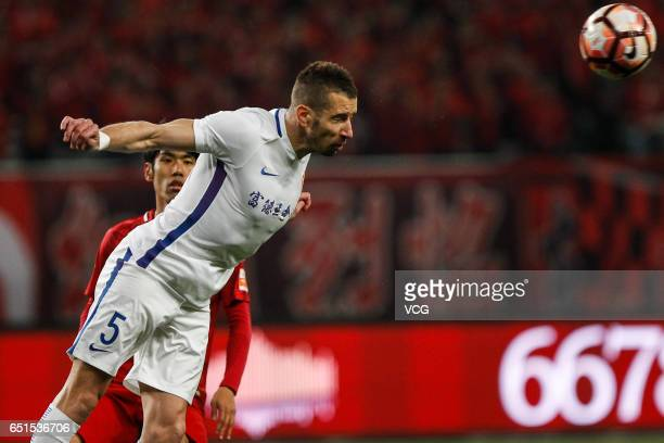 Nikola Petkovic of Yanbian Fude FC heads the ball during the 2nd round match of Chinese Super League between Shanghai SIPG and Yanbian Fude FC at...