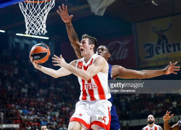 Nikola Radicevic of Crvena Zvezda in action against Kevin Seraphin of Barcelona during the 2017/2018 Turkish Airlines EuroLeague Regular Season game...