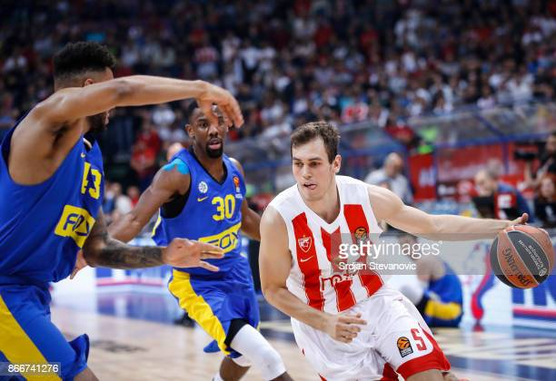 Nikola Radicevic of Crvena Zvezda in action against Norris Cole and Jonah Bolden of Maccabi during the 2017/2018 Turkish Airlines EuroLeague Regular...