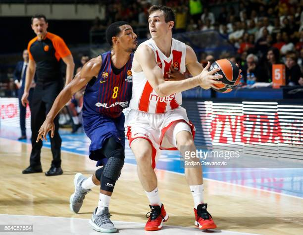 Nikola Radicevic of Crvena Zvezda is challenged by Phil Pressey of Barcelona during the 2017/2018 Turkish Airlines EuroLeague Regular Season game...