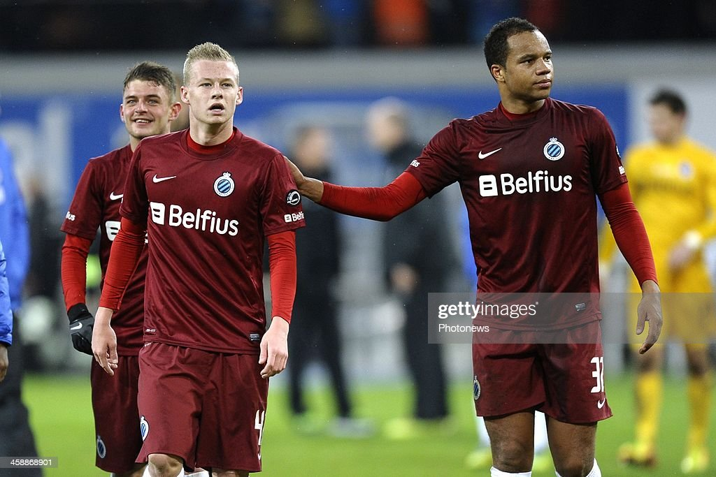 Nikola Storm of Club Brugge and Vadis Odjidja Ofoe of Club Brugge after the Jupiler League match between KAA Gent and Club Brugge on December 22, 2013 at the Ghelamco arena in Gent, Belgium.