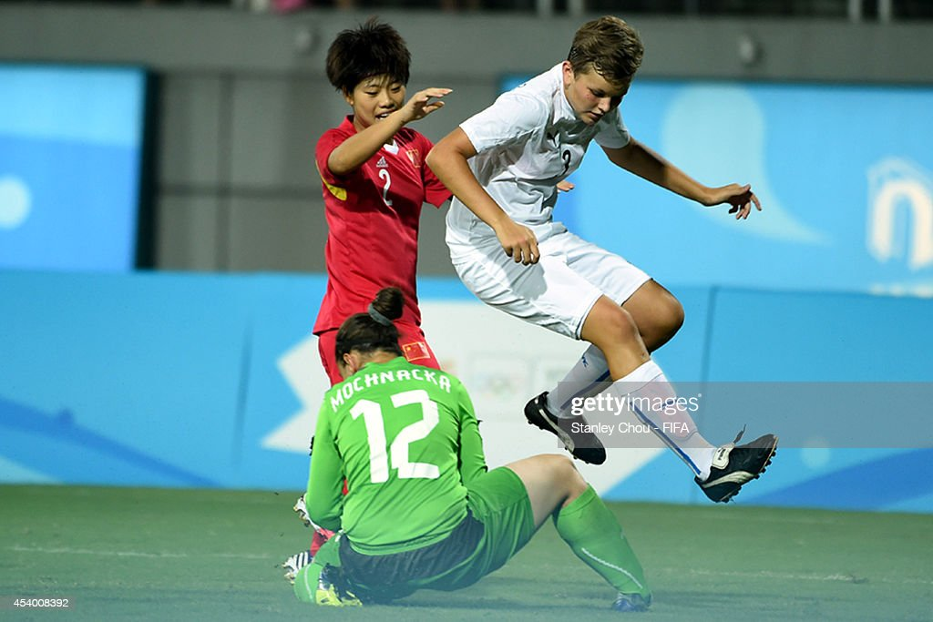 Nikola Vagaska of Slovakia shields the ball for Denisa Mochnacka when challenged by Zhang Jiayun of China during the 2014 FIFA Girls Summer Youth Olympic Football Tournament Semi Final match between China and Slovakia at Wutaishan Stadium on August 23, 2014 in Nanjing, China.