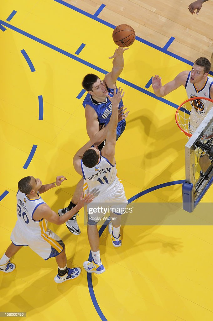 Nikola Vecevic #9 of the Orlando Magic shoots against <a gi-track='captionPersonalityLinkClicked' href=/galleries/search?phrase=Klay+Thompson&family=editorial&specificpeople=5132325 ng-click='$event.stopPropagation()'>Klay Thompson</a> #11 of the Golden State Warriors on December 3, 2012 at Oracle Arena in Oakland, California.
