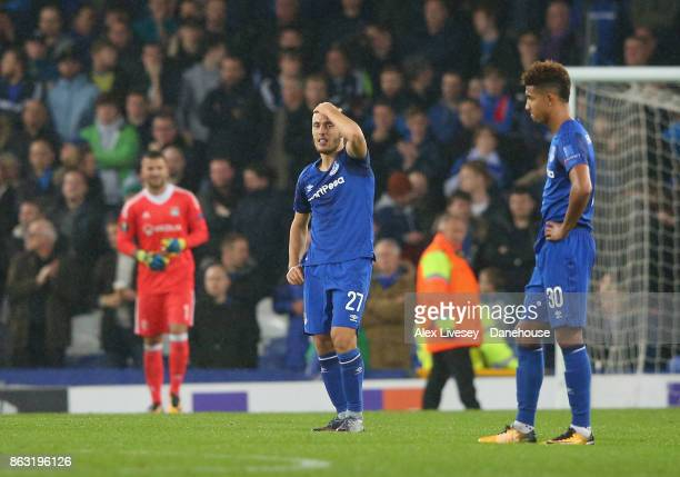 Nikola Vlasic and Mason Holgate of Everton FC look dejected after the UEFA Europa League group E match between Everton FC and Olympique Lyon at...