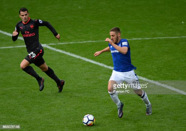 Nikola Vlasic of Everton and Granit Xhaka of Arsenal in action during the Premier League match between Everton and Arsenal at Goodison Park on...