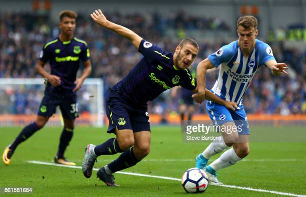 Nikola Vlasic of Everton and Solly March of Brighton and Hove Albion during the Premier League match between Brighton and Hove Albion and Everton at...
