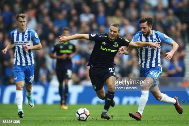 Nikola Vlasic of Everton is tackled by Davy Propper of Brighton and Hove Albion during the Premier League match between Brighton and Hove Albion and...
