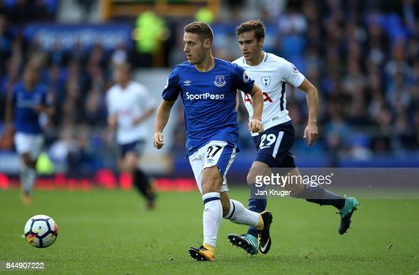 Nikola Vlsaic of Everton controls the ball from Harry Winks of Tottenham Hotspur during the Premier League match between Everton and Tottenham...