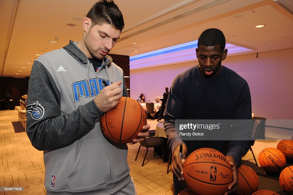Nikola Vucevic #9 and <a gi-track='captionPersonalityLinkClicked' href=/galleries/search?phrase=Andrew+Nicholson+-+Basketbalspeler&family=editorial&specificpeople=9813834 ng-click='$event.stopPropagation()'>Andrew Nicholson</a> #44 of the Orlando Magic sign autographs when they arrive at the hotel as part of 2016 London Global Games on January 1, 2016 in London, England.