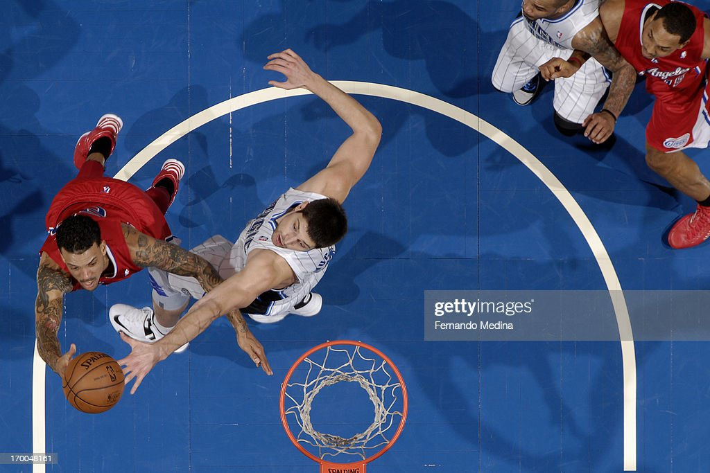 Nikola Vucevic #9 of the Orlando Magic attempt to block a shot by <a gi-track='captionPersonalityLinkClicked' href=/galleries/search?phrase=Matt+Barnes+-+Basketball+Player&family=editorial&specificpeople=202880 ng-click='$event.stopPropagation()'>Matt Barnes</a> #22 of the Los Angeles Clippers on February 6, 2013 at Amway Center in Orlando, Florida.