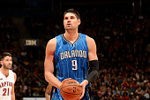 Nikola Vucevic of the Orlando Magic attempts a free throw against the Toronto Raptors on December 15 2014 at the Air Canada Centre in Toronto Ontario...